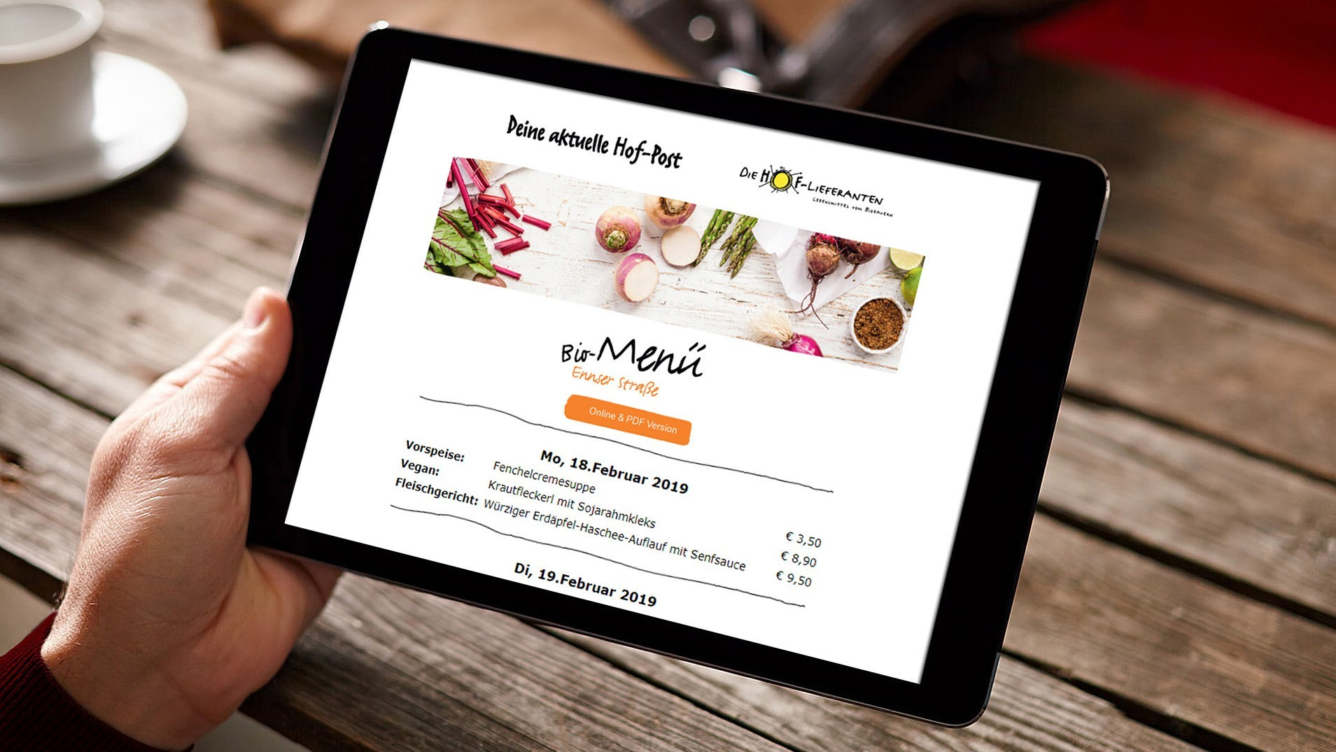 Free Tablet in Hand Mockup with Wooden Background169.jpg